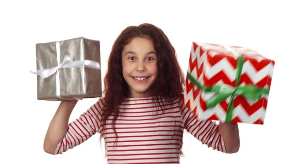 Thumbnail for Happy Girl Holding Two Christmas Gifts in Her Hands
