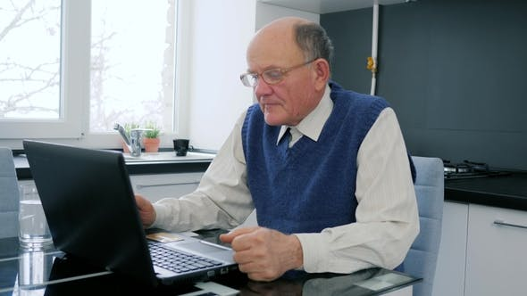 Thumbnail for Pensioner Problems , Elderly Man Works on Computer in Internet