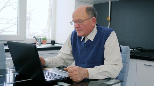 Cover Image for Pensioner Problems , Elderly Man Works on Computer in Internet