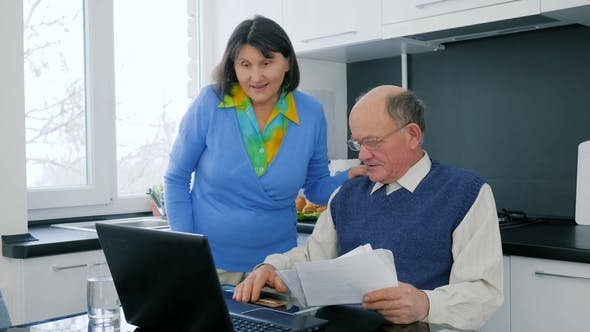 Pensioner Successful Purchase, Senior Couple with Credit Card Look at Laptop and Rejoice