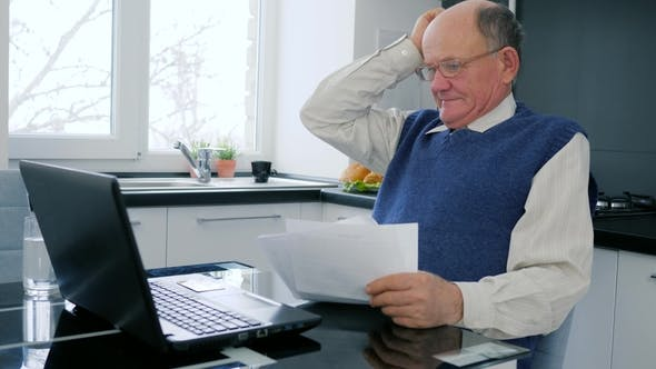 Thumbnail for Pensioner Work in Internet, Elderly Businessman Sitting in Front of Computer with Reports in Room