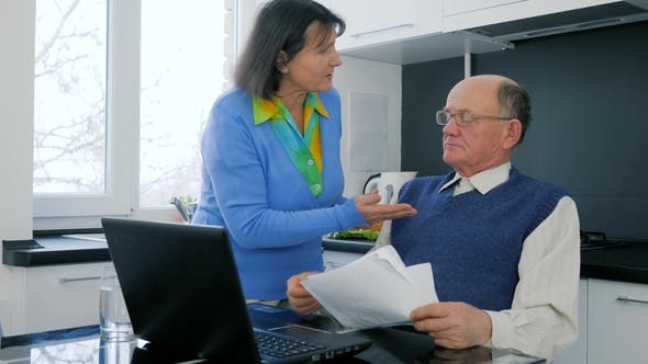Cover Image for Pensioner Family Business, Old Woman Swear with Husband Sitting Behind Laptop with Documents
