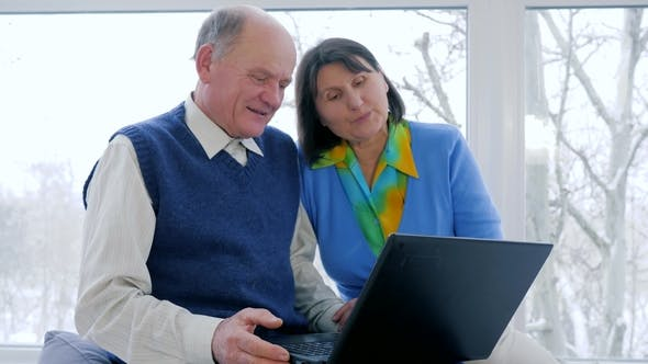 Thumbnail for Pensioner Video Communication, Old People Talk in Skype Using a Laptop at Home