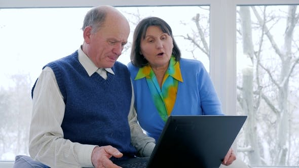 Cover Image for Internet Technology, Senior Couple Talk in Skype Using a Laptop Indoors