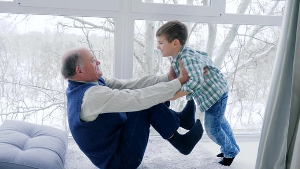 Thumbnail for Granddad Fool Around with Grandchildren Lying on Floor at Home