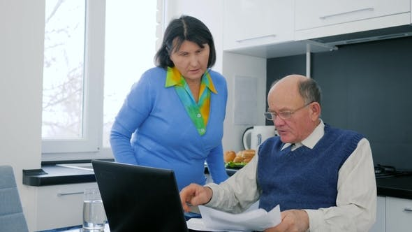 Thumbnail for Defeat in Pensioner Family Business, Married Couple with Computer Upset Because of Hopelessness