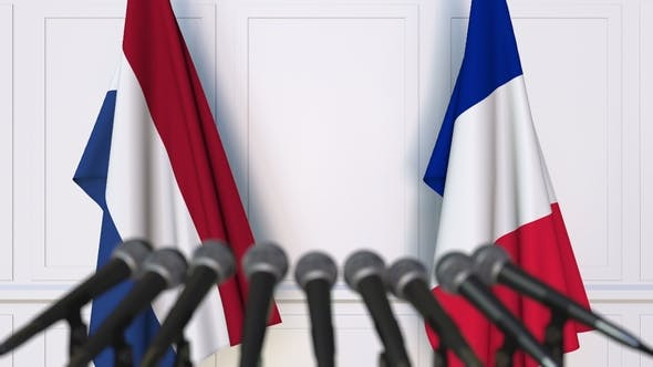 Thumbnail for Flags of the Netherlands and France at International Press Conference