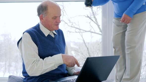 Thumbnail for Digital Technology, Old Couple Payment Online Using Video Communication and Laptop for Talk