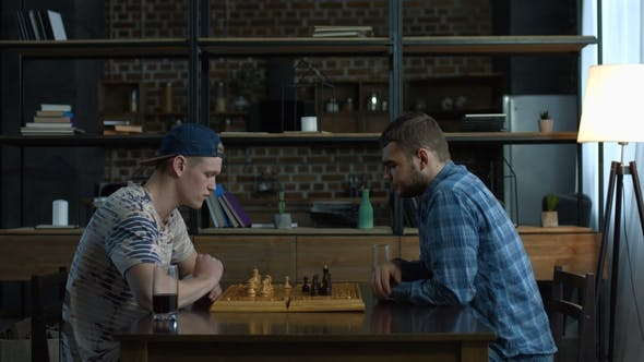Thumbnail for Two Clever Young Men Playing Chess Game at Home
