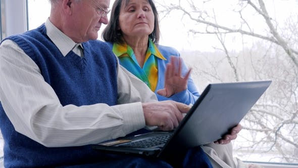 Thumbnail for Online Shopping Leisure Time, Elderly Couple with Computer Sit on Internet and Smile