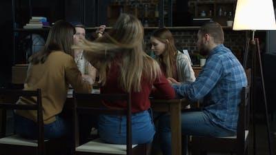 Teenagers Having Fun While Playing Board Game