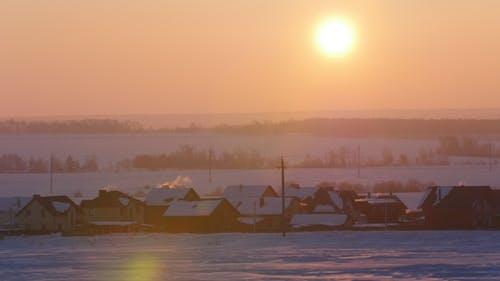 Sunrise Over Frozen Snow-covered Russian Rustic Landscape, Telephoto