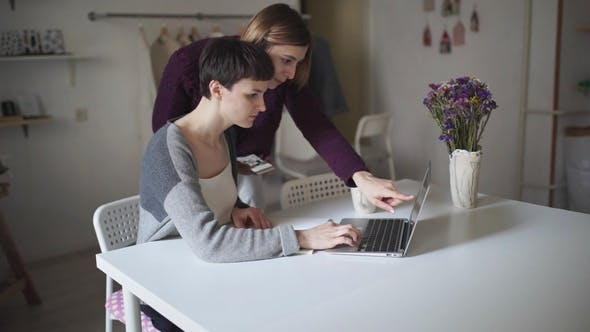 Thumbnail for Female Students Searching Internet on Laptop Computer