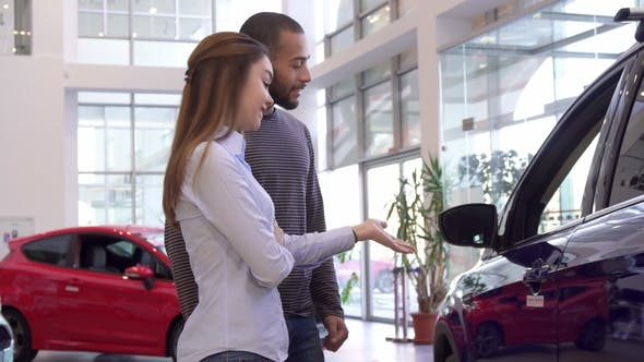 Thumbnail for Couple Chooses Car at the Dealership