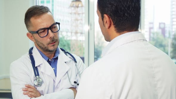 Thumbnail for Two Doctors are Having a Serious Conversation