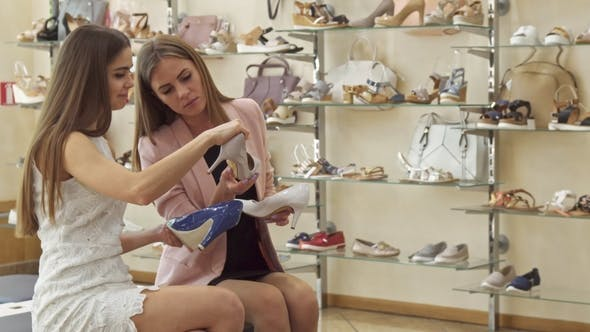 Thumbnail for Female Friends Choose Between Three Shoes at the Shop