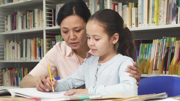 Cover Image for Cute Little Girl Doing Homework with Her Mother