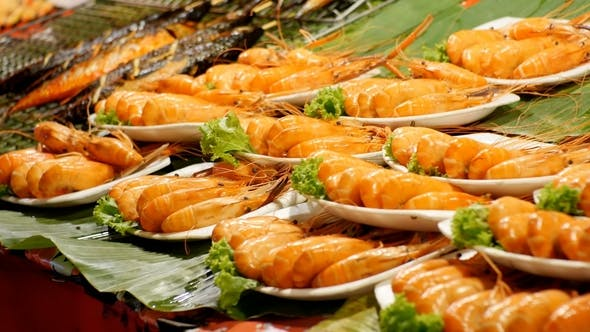 Thumbnail for Cooked Big Red Grilled Prawn on a Plate in the Asian Store. Asian Street Food Thailand Pattaya