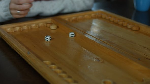 Thumbnail for Playing Backgammon on a Wooden Table with Dice