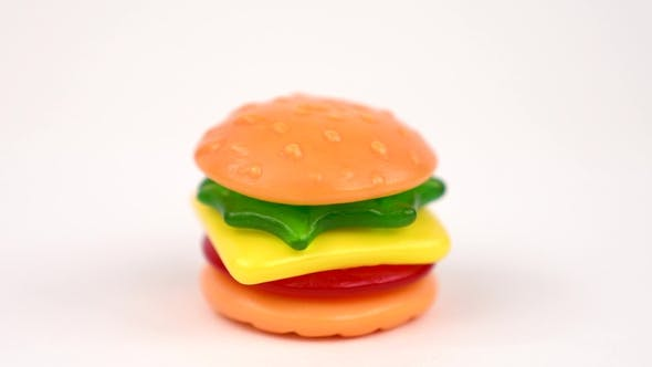 Thumbnail for Delicious Mini Gummi Burger Rotating on the the Turn Table Isolated on White Background. Candy