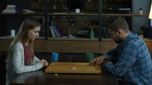 Young Attractive Couple Playing Backgammon