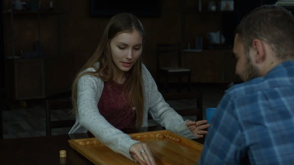 Thumbnail for Joyful Charming Girl Playing Backgammon at Home