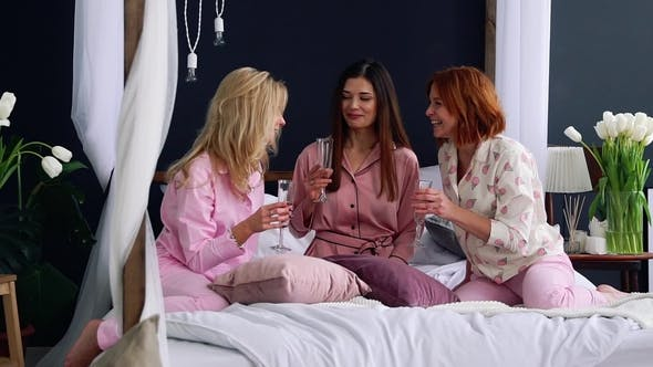 Cover Image for Three Beautiful Girls Sitting on the Bed