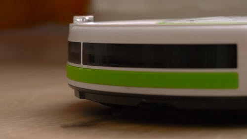 Vacuum Cleaner Robot That Cleans a Wooden Floor