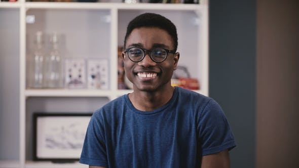 Thumbnail for Happy Black Young Guy in Glasses Smiles, Then Becomes