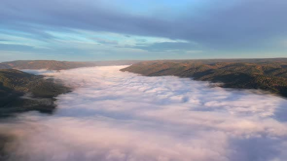 Thumbnail for Aerial View of a Stream of Fog in a Mountain Gorge, Hyperlapse.