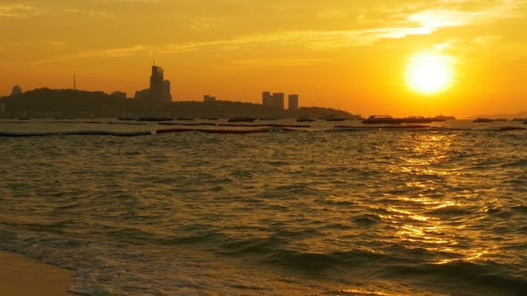 Thumbnail for Red Sunset on the Sea with Boats Swaying on the Waves. Thailand. Pattaya