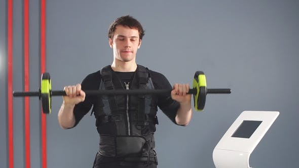Thumbnail for Man Wearing EMS Costume Working Out with Barbell.