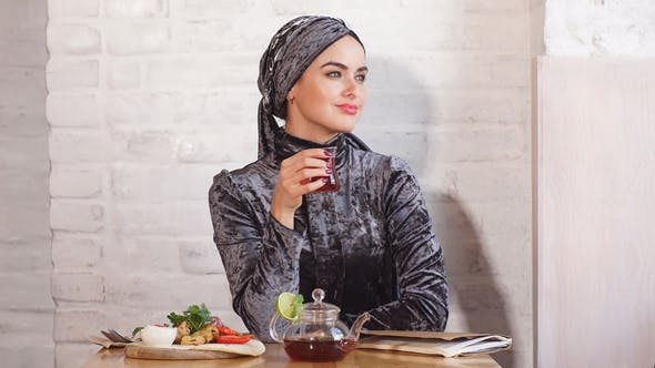 Thumbnail for Pretty Muslim Girl in Hijab in Cafe.