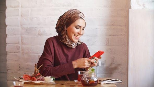 Thumbnail for Happy Muslim Woman Using Mobile Phone.