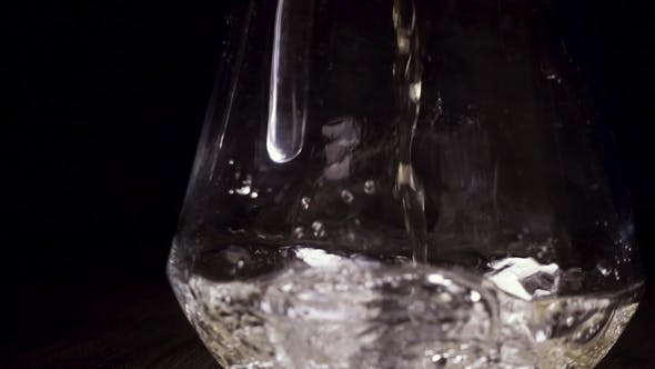 Thumbnail for White Wine Pours Into the Carafe