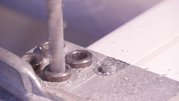 Thumbnail for Hole Being Drilled Into Aluminium and Metal Using Electric Drill Aluminium or Metal Drilling  i