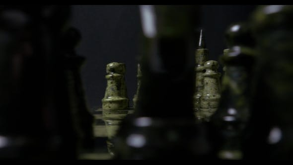 Cover Image for Chess , Wooden Chess Board, Business Concept, Black Background. Slide. Chess Pieces On Chessboard