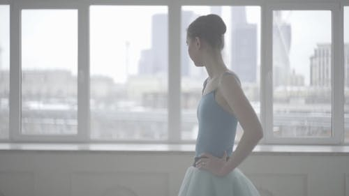 Professional Ballet Dancer Have a Rest. Tired Ballerina Restores Breathing and Resting. Tired Dancer