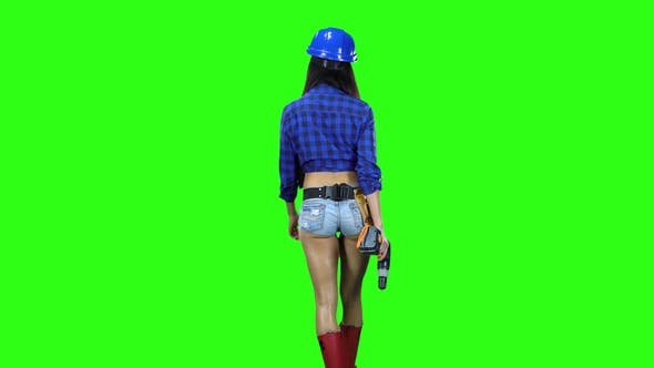Thumbnail for Girl in Helmet and Shorts with Drill in Hand Walking