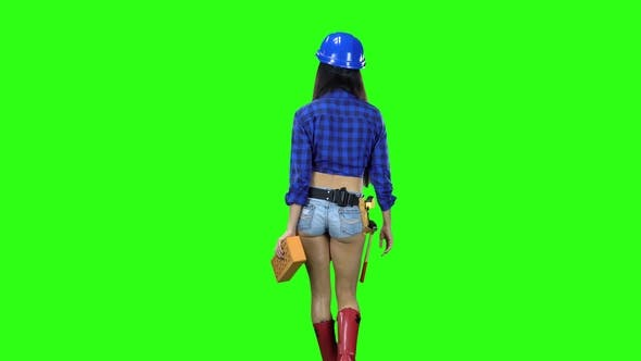 Thumbnail for Rear View of Girl in Helmet and Shorts with Brick in Hand Walking