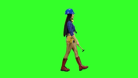 Thumbnail for Girl with Long Hair Carries a Hammer Side View on a Green Background