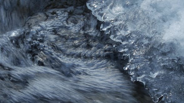Thumbnail for Frozen Mountain Stream. Under the Ice Build Up Running Mountain Stream .