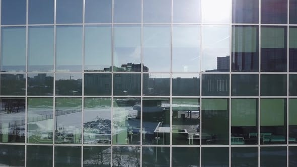 Thumbnail for Blue Glass Wall of Skyscraper with Sun Reflection. Modern Architecture with Sun Ray From Right