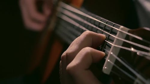 Practicing in Playing Guitar. Handsome Young Men Playing Guitar. Play the Guitar. Hands Playing