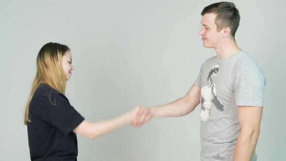 Thumbnail for Man and Girl Shaking Hands on White Background.  Portrait of Couple, Man Woman Shaking Isolated o