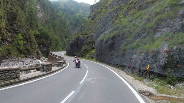 Thumbnail for Motorcyclist Rides on a Beautiful Landscape Mountain Road in Austria