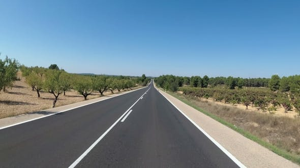 Cover Image for Motorcyclist Rides on a Beautiful Landscape Desert Scenic and Empty Road in Spain