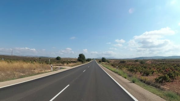 Thumbnail for Motorcyclist Rides on a Landscape Desert Scenic and Empty Road in Spain