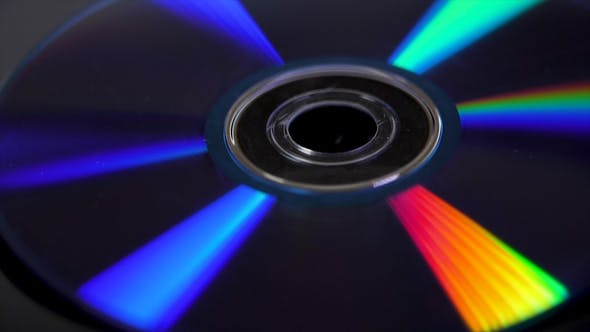 Thumbnail for Compact Disk Isolated on Black Background. Abstract   of Colorful Rainbow Reflection From Compact Di