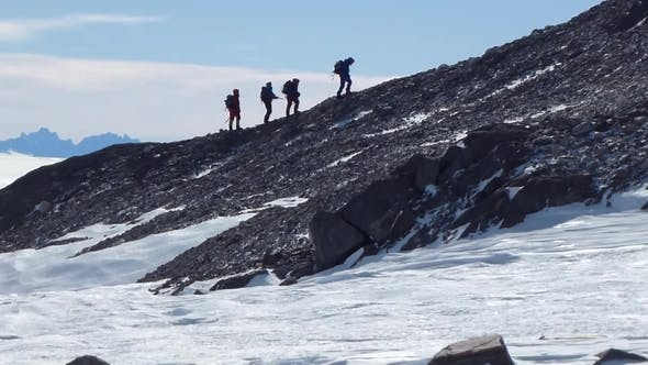 Thumbnail for Group of Mountain Backpackers Walking on Snow. Climb To Mountain. Walking in the Mountains